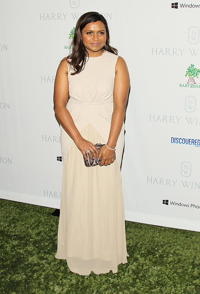 Despite the fact that she's not part of the mommy pack, Mindy Kaling showed up to support the cause and looked pretty in a pastel Max Mara gown. (11/23/12)