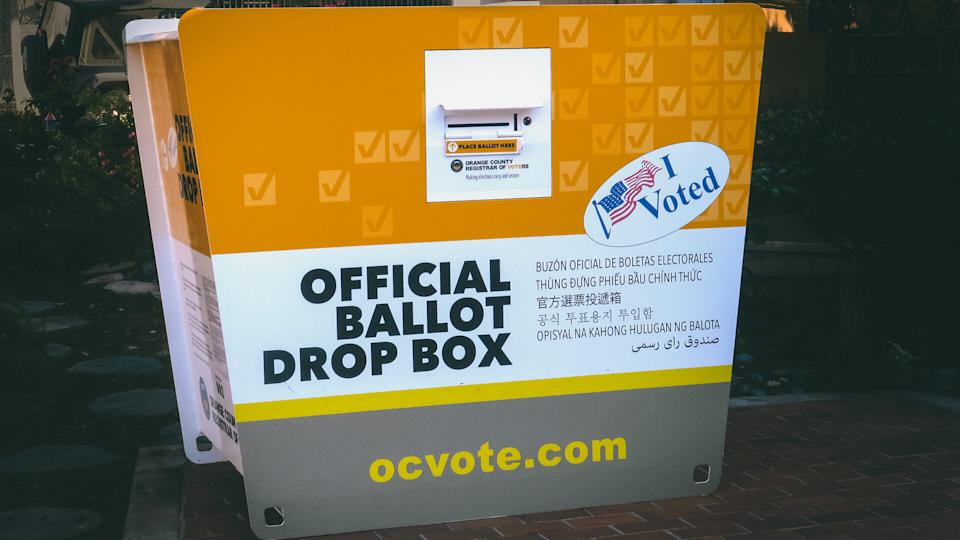 portable official ballot drop off box for the CA presidential primary, outside the library in downtown Laguna Beach, CA.