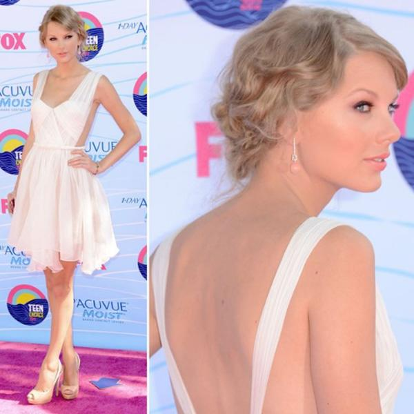"Taylor Swift stunned the crowed upon arrival at the 2012 Teen choice Awards in a short, white Maria Lucia Hoan dress with a cutout back that showed off her mile-long gams. The 22-year-old songstress wore her hair swept up in a chic updo and accessorized the romantic frock with Lorraine Schwartz jewels, a sparkly Edie Parker clutch, and nude peep-toe heels. There's no denying that the country cutie looked sweet and sexy in the backless dress, but we can't help but think it's a drawback that she's always wearing white to awards shows. Along with presenting, Taylor is nominated for five awards this year : Choice Voice for ""The Lorax,"" Choice Female Artist, Choice Single by a Female Artist for ""Eyes Open,"" Choice Female Country Artist, and Choice Country Song for ""Sparks Fly."""