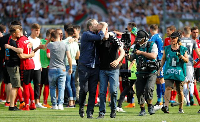 Soccer Football - Bundesliga - SC Freiburg v FC Augsburg - Schwarzwald-Stadion, Freiburg, Germany - May 12, 2018 SC Freiburg coach Christian Streich celebrates after the match after staying in the Bundesliga REUTERS/Kai Pfaffenbach DFL RULES TO LIMIT THE ONLINE USAGE DURING MATCH TIME TO 15 PICTURES PER GAME. IMAGE SEQUENCES TO SIMULATE VIDEO IS NOT ALLOWED AT ANY TIME. FOR FURTHER QUERIES PLEASE CONTACT DFL DIRECTLY AT + 49 69 650050