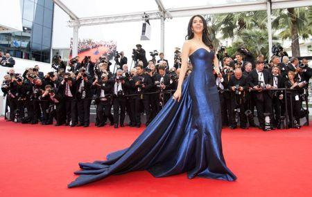 "Actress Mallika Sherawat poses on the red carpet as she arrives for the screening of the film ""Macbeth"" in competition at the 68th Cannes Film Festival in Cannes"