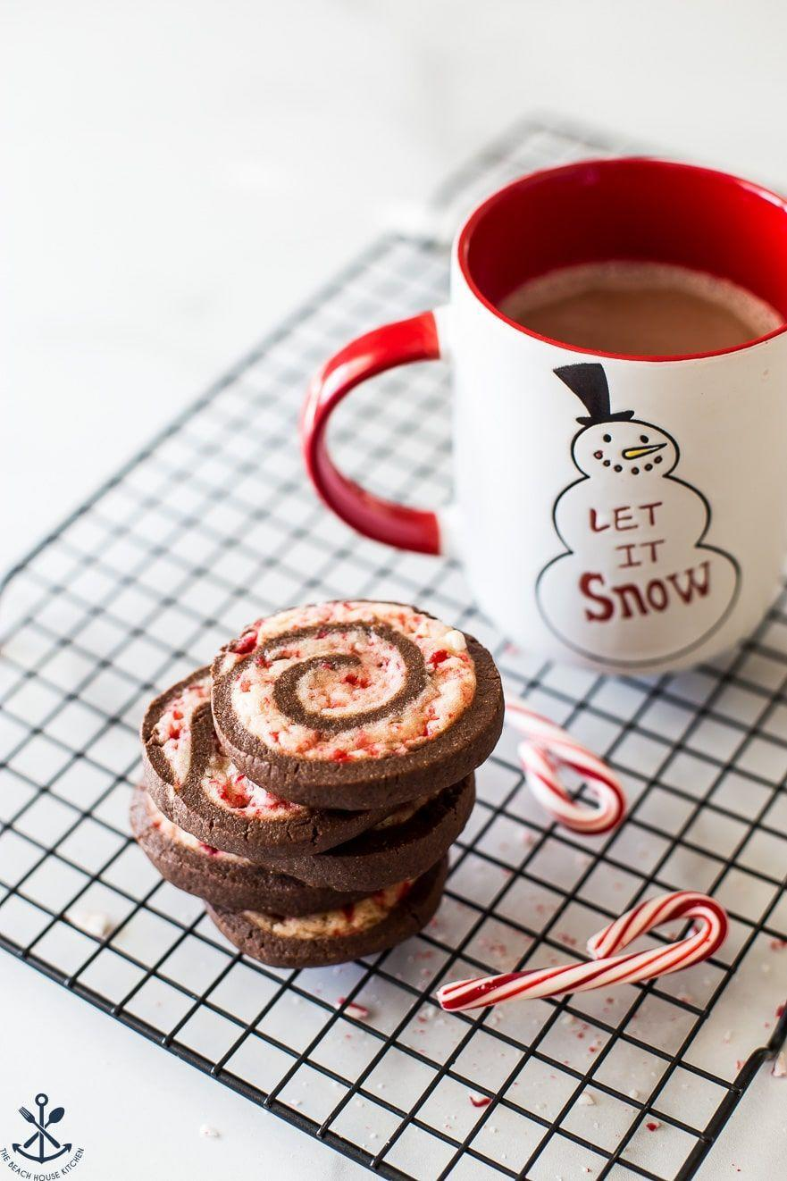 """<p>Festive cookies that are sure to delight anyone who loves the quintessential chocolate and peppermint combo. </p><p><a href=""""https://thebeachhousekitchen.com/2019/12/16/chocolate-peppermint-pinwheel-cookies/"""" rel=""""nofollow noopener"""" target=""""_blank"""" data-ylk=""""slk:Get the recipe"""" class=""""link rapid-noclick-resp"""">Get the recipe</a>.</p>"""