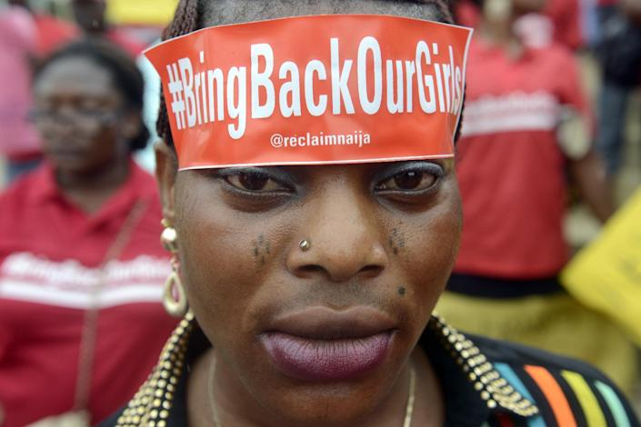 """A woman with a sticker on her head bearing the slogan """"Bring back our girls"""" marches for the release of the abducted Chibok school girls in Lagos on May 29, 2014 (AFP Photo/Pius Utomi Ekpei)"""