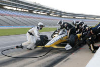 The team of Josef Newgarden makes adjustments and changes tires midway through through an IndyCar auto race at Texas Motor Speedway in Fort Worth, Texas, Saturday, June 6, 2020. (AP Photo/Tony Gutierrez)