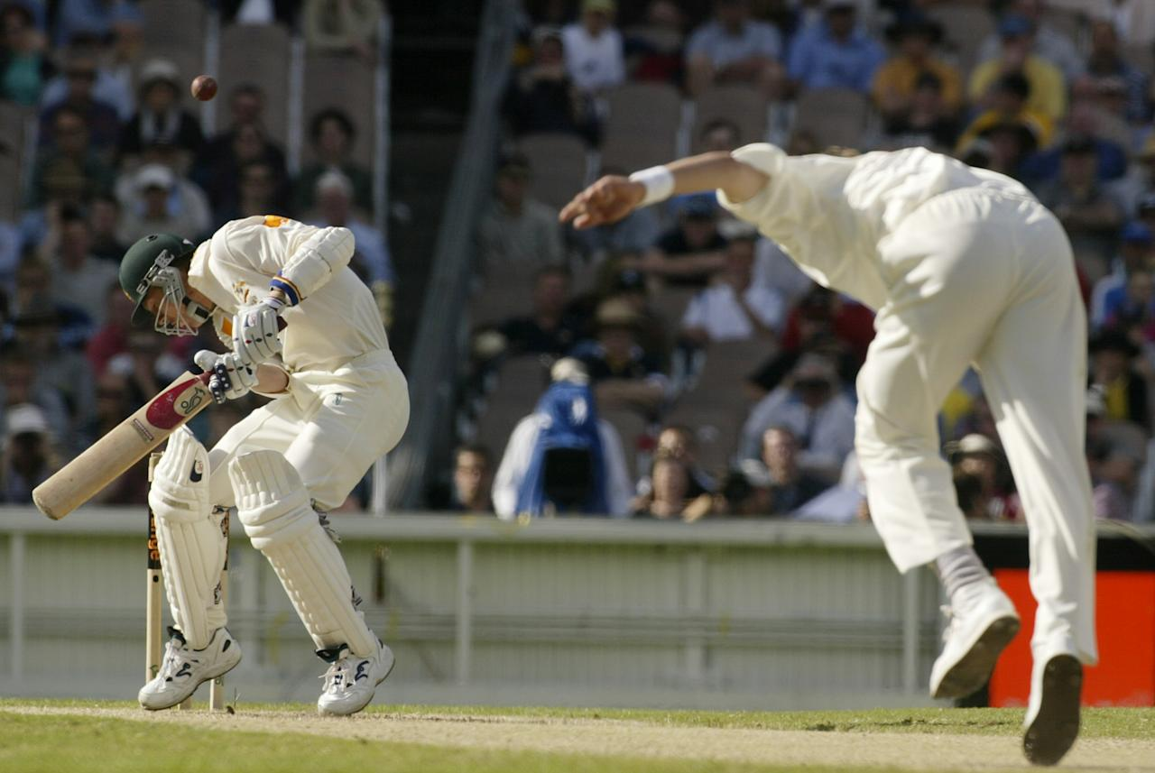 28 Dec 2001:  Brett Lee of Australia ducks under a bouncer from Allan Donald of South Africa, caught by Mark Boucher for five, during day three of the second Test between Australia and South Africa, played at the Melbourne Cricket Ground, Melbourne, Australia. DIGITAL IMAGE. Mandatory Credit: Hamish Blair/Getty Images