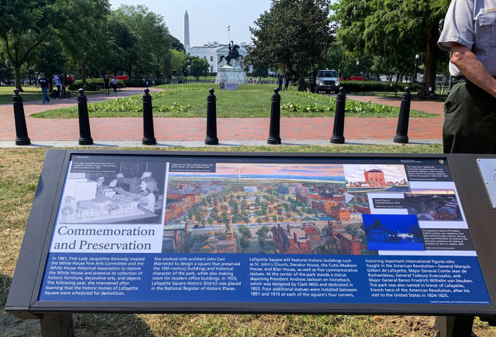 A new historical marker that focuses on former first lady Jacqueline Kennedy, who formed the White House Historical Association in 1961, is displayed at the northern end of Lafayette Park on Wednesday, July 28, 2021, in Washington. The White House Historical Association on Wednesday unveiled three new historical markers at the northern end of Lafayette Park. (AP Photo/Ashraf Khalil)