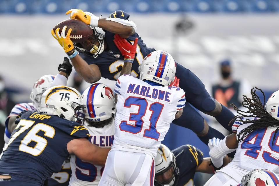 Los Angeles Chargers running back Joshua Kelley (27) dives in for a touchdown during the second half of an NFL football game against the Buffalo Bills, Sunday, Nov. 29, 2020, in Orchard Park, N.Y. (AP Photo/Adrian Kraus)