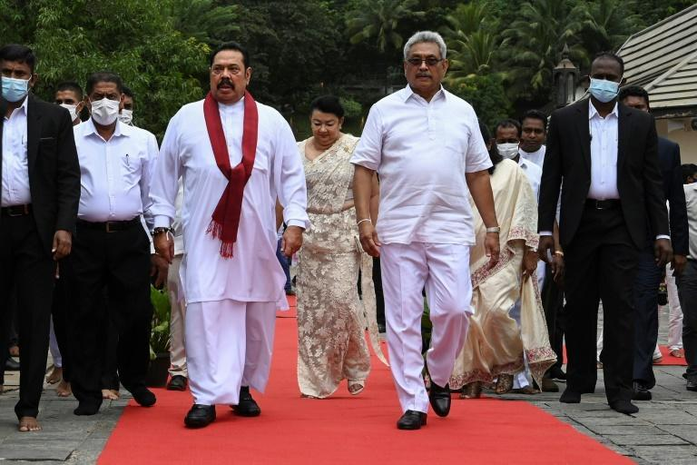 President Gotabaya Rajapaksa (right) was the top defence official when government forces crushed the guerrillas. His brother Mahinda (left) was president then and is currently prime minister