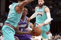 Memphis Grizzlies guard Ja Morant (12) defends against Charlotte Hornets guard Terry Rozier (3) in the first half of an NBA basketball game Sunday, Dec. 29, 2019, in Memphis, Tenn. (AP Photo/Karen Pulfer Focht)
