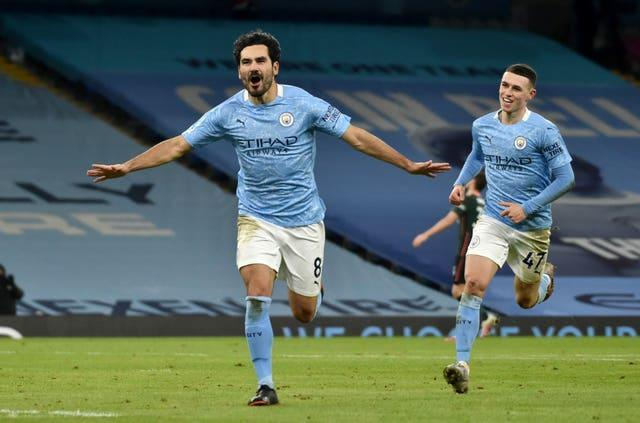 Ilkay Gunodgan scored twice as Manchester City beat Tottenham 3-0 for a 16th successive win on Saturday