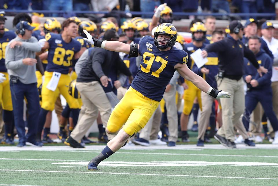 Michigan defensive lineman Aidan Hutchinson celebrates after sacking Iowa quarterback Nate Stanley during the second half of U-M's 10-3 win on Saturday, Oct. 5, 2019, at Michigan Stadium.