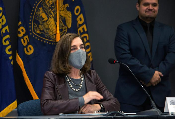 Oregon Gov. Kate Brown attends a news conference Tuesday, Nov. 10, 2020, in Portland. Brown and Oregon health officials warned Tuesday of the capacity challenges facing hospitals as COVID-19 case counts continue to spike in the state.