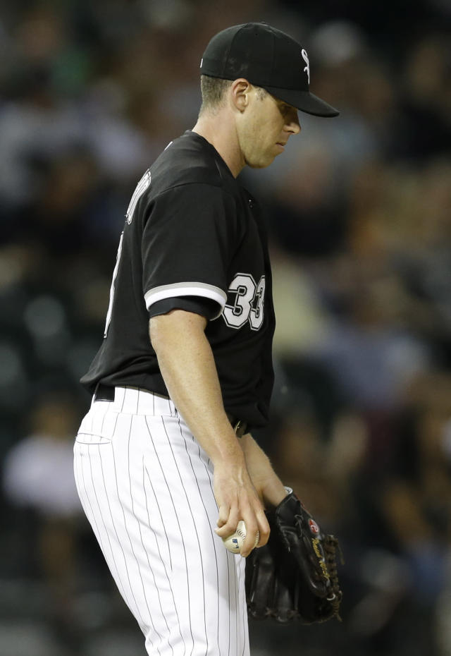 Chicago White Sox relief pitcher Dylan Axelrod looks down after Minnesota Twins' Oswaldo Arcia hit a solo home run during the 10th inning of the second baseball game of a doubleheader in Chicago, Friday, Aug. 9. 2013. (AP Photo/Nam Y. Huh)