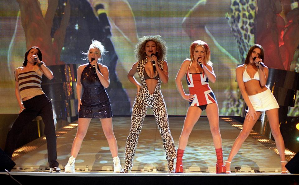 <p>It's hard to believe it was 20 years ago this year that Geri wore THAT dress and Spice Girls mania was in full swing. The girls performed on stage at the 1997 Brit Awards and Geri became a fancy dress icon when she flashed her knickers in this Union Jack dress. (Photo: Fiona Hanson PA Archive/PA Images) </p>