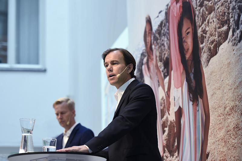 Karl-Johan Persson, chief executive officer of Hennes & Mauritz AB (H&M), right, speaks as Nils Vinge, head of investor relations at Hennes & Mauritz AB, listens during an earnings news conference in Stockholm, Sweden, on Thursday, June 29, 2017. Cost-control is the new watchword atHennes & Mauritz ABas the European fashion giant seeks to compensate for slowing sales growth, rising inventories and dwindling profitability. Photographer: Mikael Sjoberg/Bloomberg via Getty Images