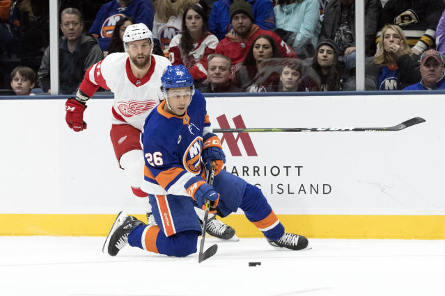 New York Islanders right wing Joshua Ho-Sang (26) skates against Detroit Red Wings center Luke Glendening (41) during the first period of an NHL hockey game, Saturday, Dec. 15, 2018, in Uniondale, N.Y. (AP Photo/Mary Altaffer)