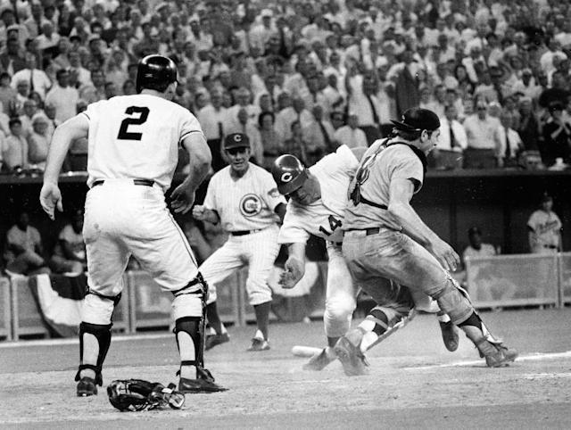 FILE - In this July 14, 1970 file photo, Cincinnati Reds' Pete Rose (14) slams into Cleveland Indians' catcher Ray Fosse to score a controversial game-winning run for the National League team in the 12th inning of the 1970 All-Star game in Cincinnati. Fosse suffered a fractured shoulder in the collision. Looking on are the Reds' third base coach Leo Durocher, and Cincinnati Reds' next hitter Dick Dietz (2). Major League Baseball plans to eliminate home plate collisions, possibly as soon as next season but no later than by 2015. New York Mets general manager Sandy Alderson, chairman of the rules committee, made the announcement Wednesday, Dec. 11, 2013 at the winter meetings. Player safety and concern over concussions were major factors in the decision. (AP Photo/File)