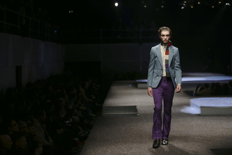 A model wears a creation for Prada men's Fall-Winter 2014 collection, part of the Milan Fashion Week, unveiled in Milan, Italy, Sunday, Jan.12, 2014. (AP Photo/Luca Bruno)