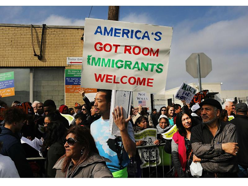 Pro-immigration protesters pictured at a rally in New Jersey: Getty