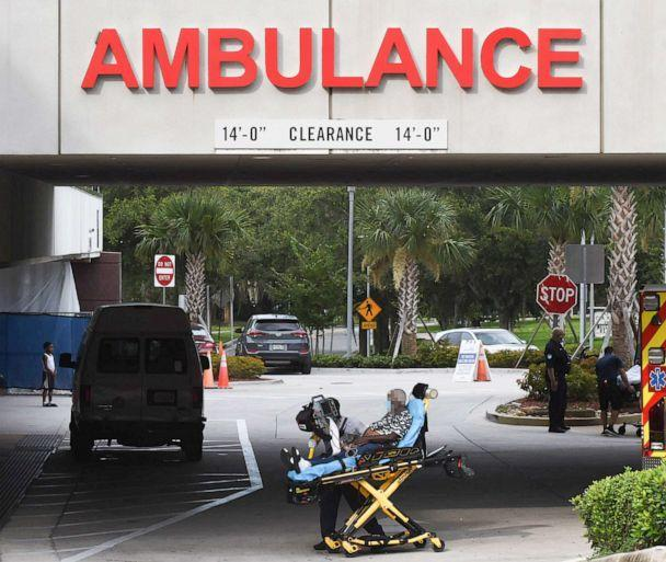 PHOTO: A patient is brought on a gurney to the emergency department at AdventHealth hospital in Orlando, Fla., July 26, 2021. (SOPA Images/LightRocket via Getty Images)