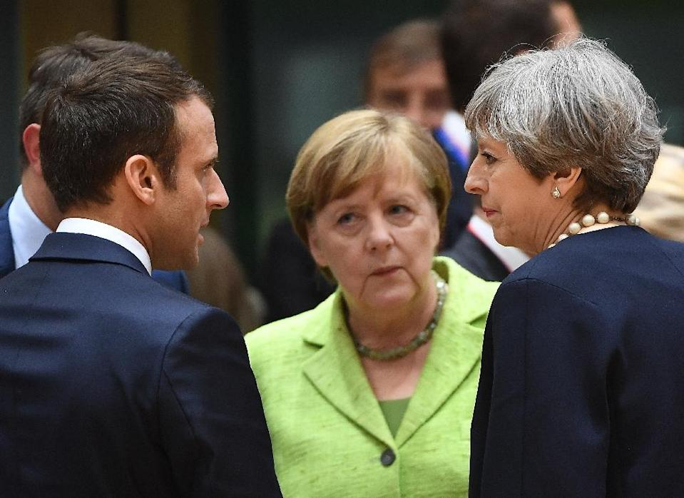 The leaders of France, Germany and Britain -- all signatories to the Iran nuclear deal -- said they will work on keeping the accord in place (AFP Photo/EMMANUEL DUNAND)