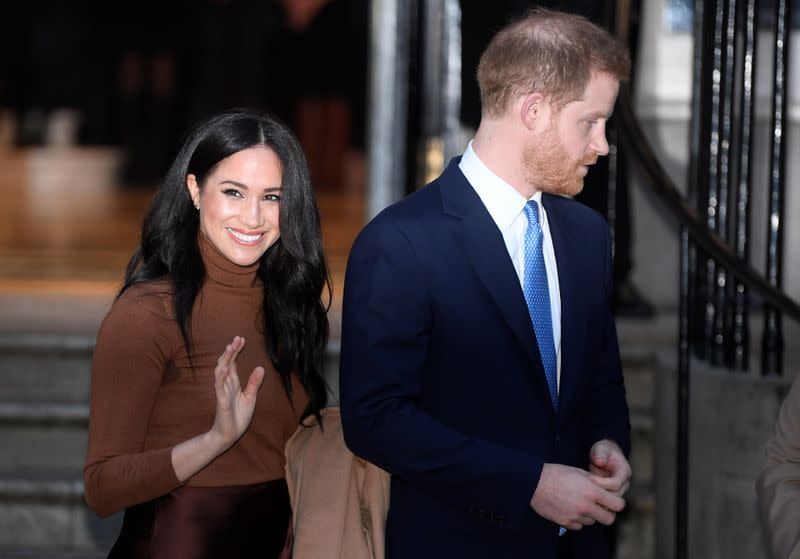 Britain's Prince Harry and his wife Meghan, Duchess of Sussex, leave Canada House in London
