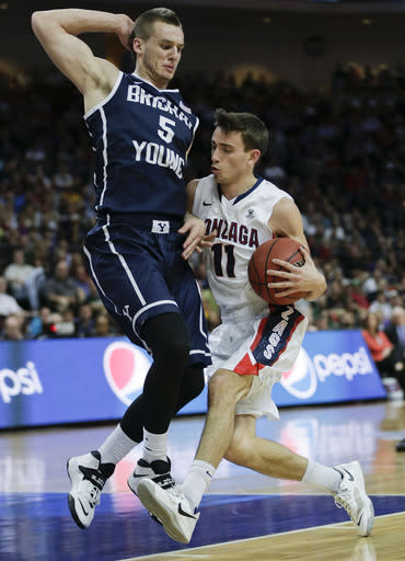 Gonzaga's David Stockton (11) drives against BYU's Kyle Collinsworth (5) in the first half of the NCAA West Coast Conference tournament championship college basketball game, Tuesday, March 11, 2014, in Las Vegas. (AP Photo/Julie Jacobson)