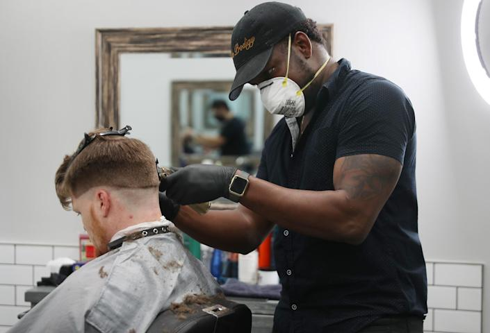 Ascend the Trend Barbershop in Palm Beach is open for business, May 11, 2020. (Joe Raedle/Getty Images)