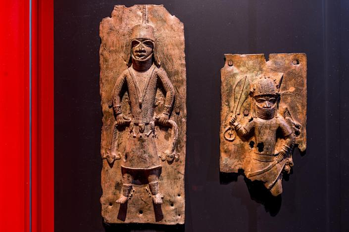 Sculptures looted by British soldiers from the Kingdom of Benin in 1897 hangs on display in the 'Where Is Africa' exhibition at the Linden Museum on May 05, 2021 in Stuttgart, Germany (Getty Images)