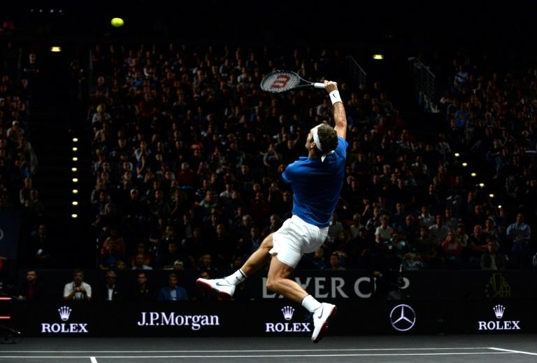 Swiss tennis player Roger Federer of Team Europe returns a ball to Sam Querrey (not in picture) of the United States and Team World during the second day of the Laver Cup on September 23, 2017 in Prague