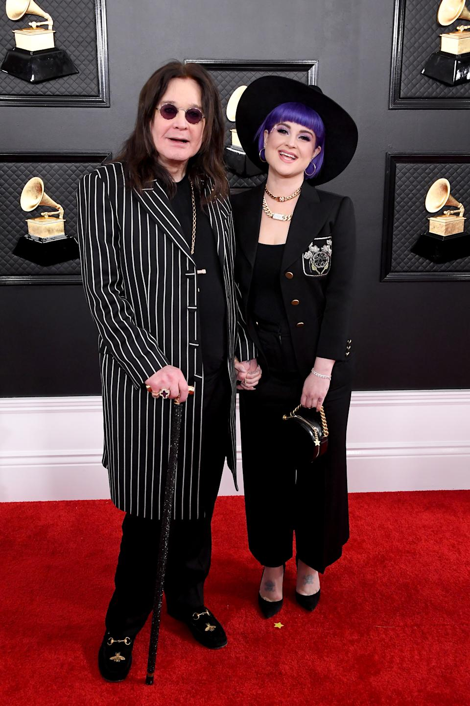 The 71-year-old rock legend and Grammy presenter arrived on the red carpet with daughter Kelly, days after revealing he was diagnosed with Parkinson's disease.