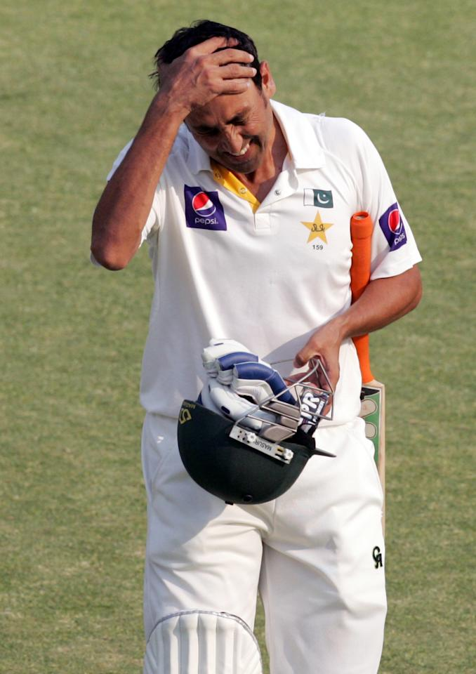 Pakistan's batsman Younis Khan reacts after losing his wicket on the fourth day of the second test match between Pakistan and Zimbabwe at the Harare Sports Club on September 13, 2013. AFP PHOTO / JEKESAI NJIKIZANA        (Photo credit should read JEKESAI NJIKIZANA/AFP/Getty Images)