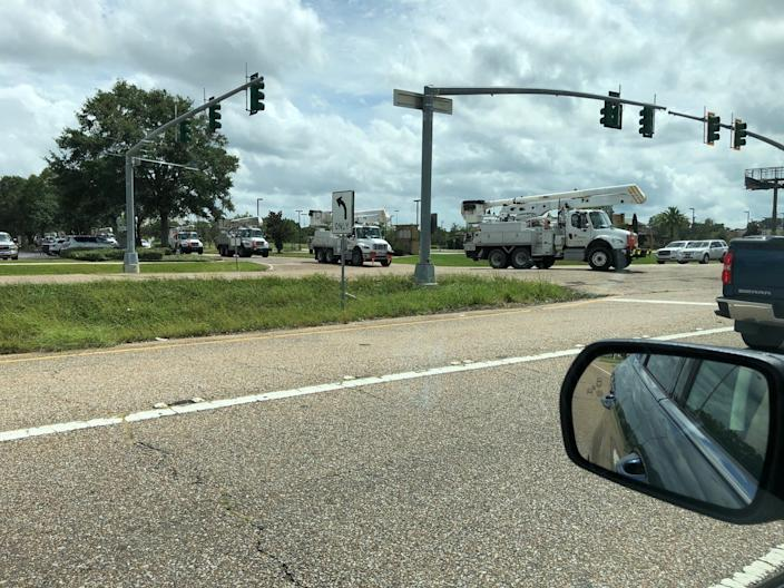 Power trucks in the aftermath of Hurricane Laura in Lafayette, Louisiana, in August 2020.