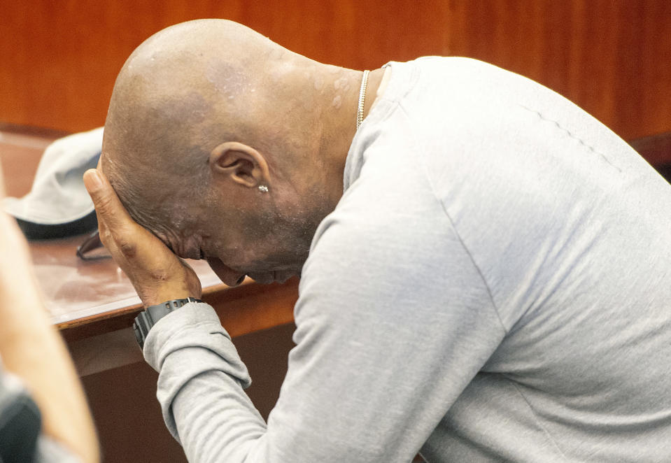 Plaintiff Dewayne Johnson reacts after hearing the verdict in his case against Monsanto at the Superior Court of California in San Francisco on Friday, Aug. 10, 2018. A San Francisco jury on Friday ordered agribusiness giant Monsanto to pay $289 million to the former school groundskeeper dying of cancer, saying the company's popular Roundup weed killer contributed to his disease. (Josh Edelson/Pool Photo via AP)