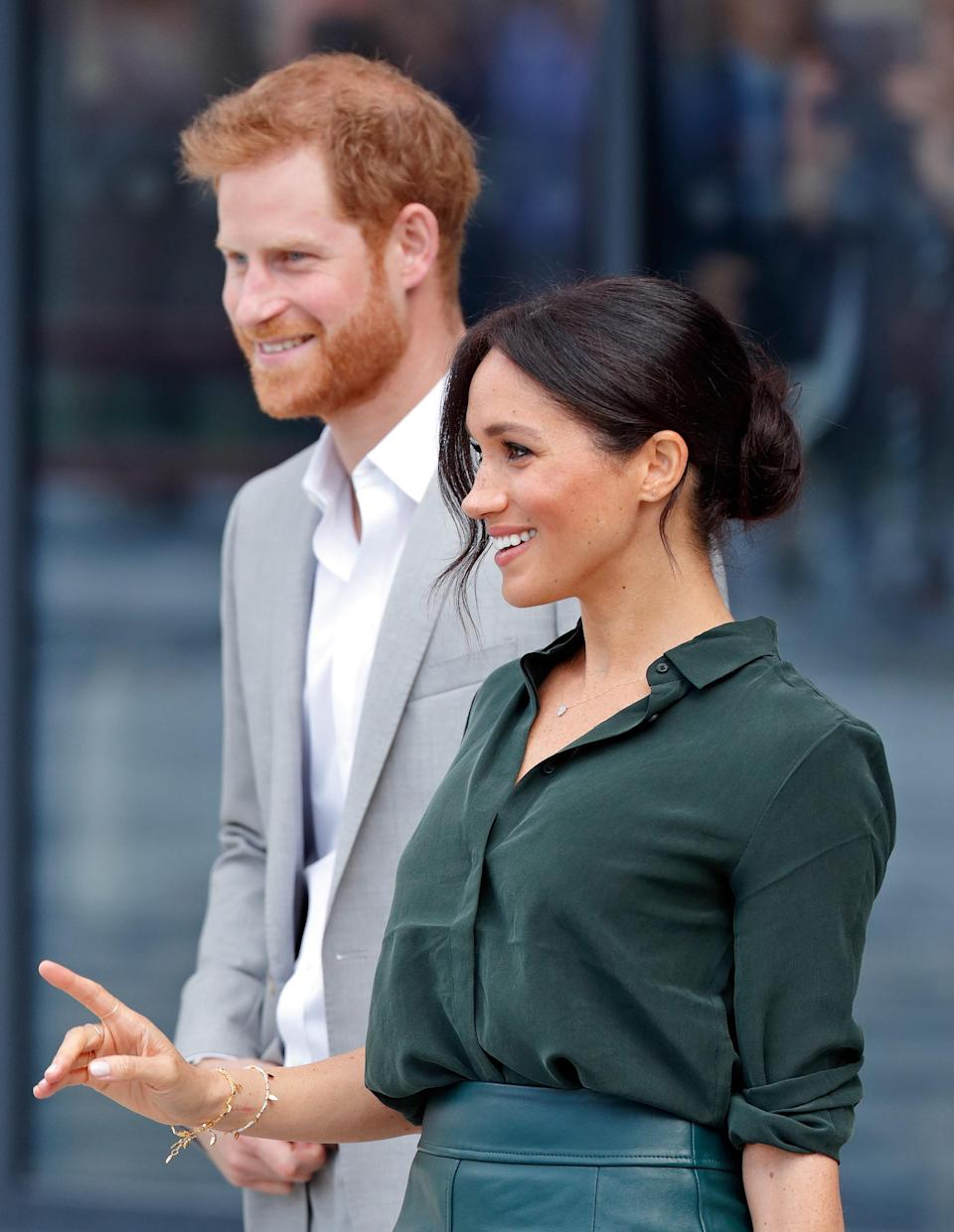Meghan Markle and Prince Harry are photographed smiling