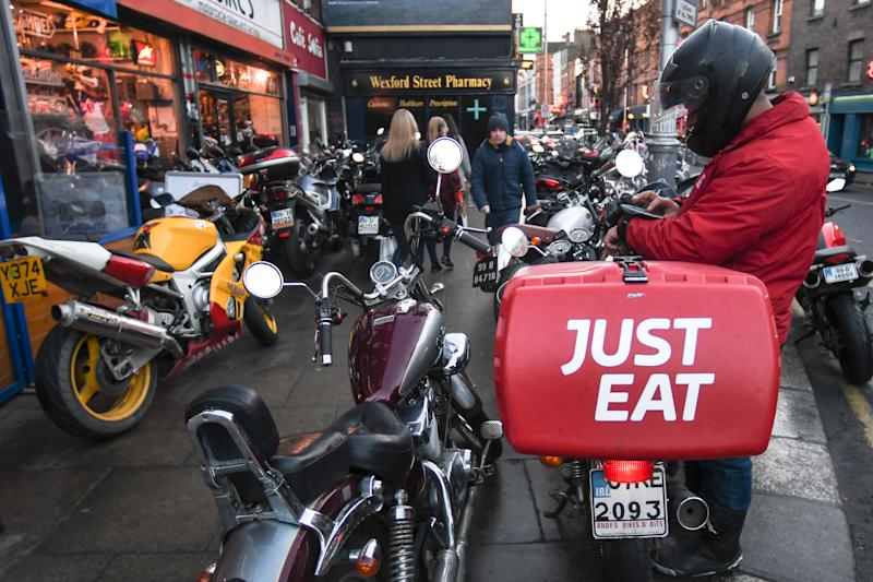A staff of takeaway food online 'Just Eat' seen on Camden Street in Dublin. On Saturday, 14 January 2017, Dublin, Ireland. (Photo by Artur Widak/NurPhoto via Getty Images)