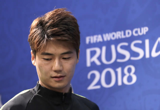 South Korea's Ki Sung-yueng arrives for the press conference before South Korea's official training on the eve of the group F match between Sweden and South Korea at the 2018 soccer World Cup in the Nizhny Novgorod stadium in Nizhny Novgorod, Russia, Sunday, June 17, 2018. (AP Photo/Lee Jin-man)