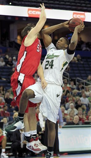 South Florida forward/center Augustus Gilchrist (24) shoots in front of Rutgers forward Gilvydas Biruta (55) during the first half of an NCAA college basketball game, Sunday Jan. 1, 2012, in Tampa, Fla. (AP Photo/Chris O'Meara)