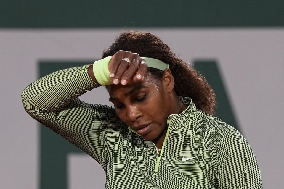 United States Serena Williams wipes her brow as she plays against Romania's Irina-Camelia Begu during their first round match on day two of the French Open tennis tournament at Roland Garros in Paris, France, Monday, May 31, 2021. (AP Photo/Michel Euler)