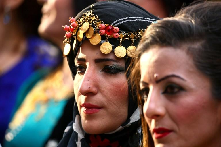 <p>Syrian-Kurdish women model traditional Kurdish attire during a fashion show in the northeastern Syrian city of Qamishli on March 10, 2017, which coincides with the Day of Kurdish Clothing.<br />Such outfits would not have been seen in public in Syria's Kurdish regions in years past, under restrictions on the minority that also banned their language and denied them Syrian nationality. But after Syria's uprising began in March 2011, the government first relaxed some restrictions and then in 2012 withdrew most of its forces from Kurdish-majority areas in the country's north.<br />/ AFP PHOTO / DELIL SOULEIMAN / TO GO WITH AFP STORY BY DELIL SOULEIMAN </p>