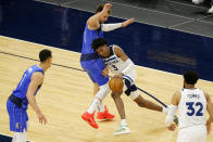 Dallas Mavericks guard Luka Doncic (77) defends against Minnesota Timberwolves forward Jaden McDaniels (3) in the first quarter during an NBA basketball game, Sunday, May 16, 2021, in Minneapolis. (AP Photo/Andy Clayton-King)