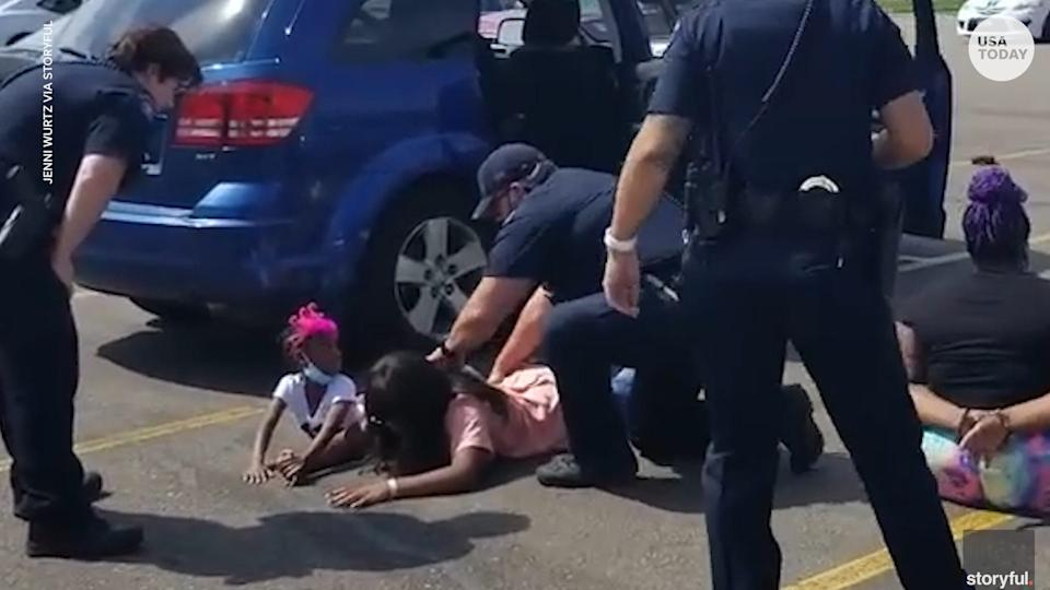 Aurora, Colo., police officers drew their guns and handcuffed a woman and four children after mistaking their car for a stolen vehicle.