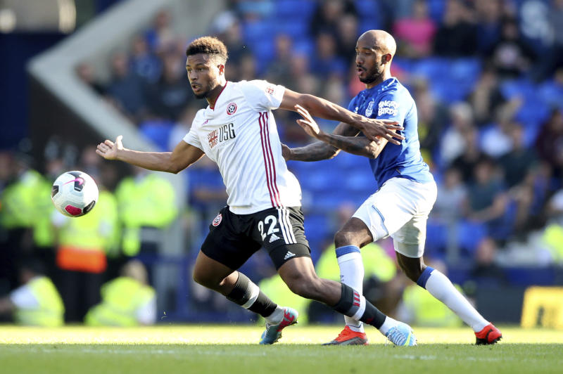 Sheffield United's Lys Mousset, left, and Everton's Fabian Delph battle for the ball during the English Premier League soccer match at Goodison Park, Liverpool, England, Saturday Sept. 21, 2019. (Nick Potts/PA via AP)