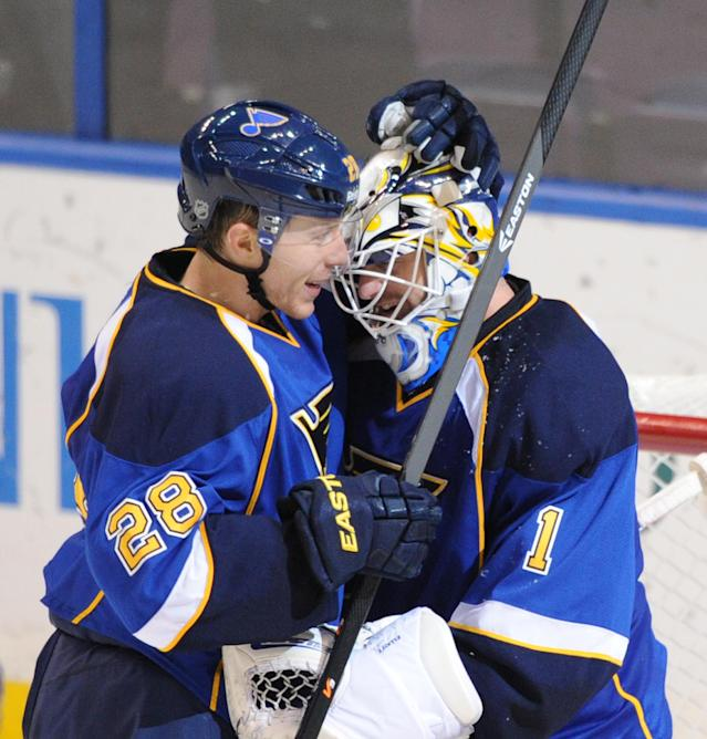 St. Louis Blues goalie Brian Elliott (1) is congratulated by teammate Ian Cole (28) after his shutout victory over the Los Angeles Kings in an NHL hockey game on Thursday, Jan. 2, 2014, in St. Louis. The Blues won 5-0. (AP Photo/Bill Boyce)