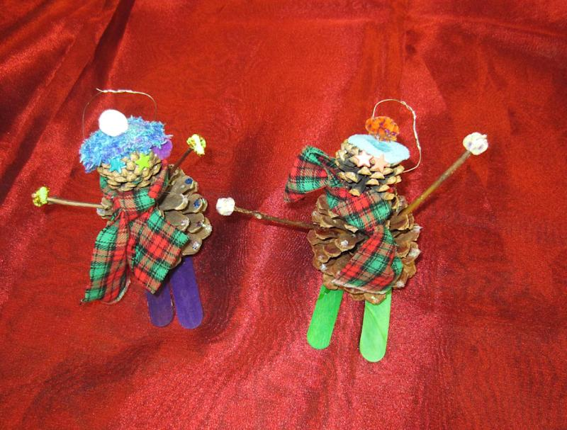 "This undated publicity photo provided by Mary Cunningham shows skiers as ornaments created by the fourth-grade students of Limon Elementary School, of the small town of Limon, on the Eastern plains of Colorado, who gathered pine cones to make skiers to suit the 2012 Capitol Christmas tree campaign theme, ""Celebrating Our Great Outdoors."" These handmade ornaments are among 10,000 crafted and donated by school children and other Colorado residents to the Capitol Christmas tree campaign.  Some of the ornaments will adorn the 73-foot Engelmann spruce destined for the West Lawn of the U.S. Capitol while others will decorate nearly 70 smaller trees, also from Colorado, destined for government office buildings in Washington, D.C., this holiday season. (AP Photo/Mary Cunningham, Mary Cunningham)"