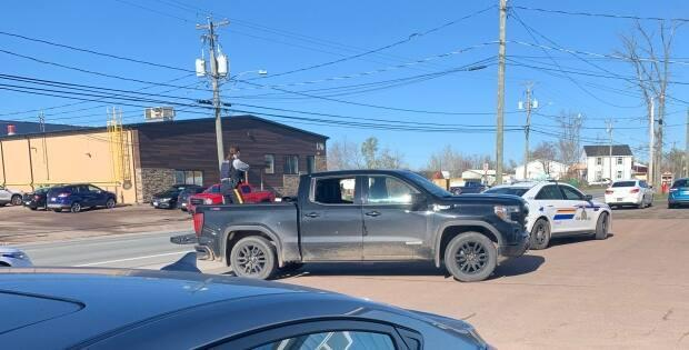 Steven Parker, owner of Boyd's Auto Body in Millennium Boulevard, said he was at his business on Thursday morning when he saw a pickup truck pull up with two bullet holes and smashed rear windows.