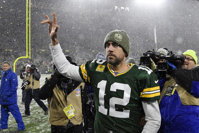 Aaron Rodgers and the Packers held on in the snow to top the Panthers. (Quinn Harris/Getty Images)