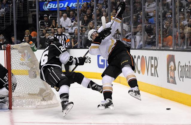 Los Angeles Kings defenseman Slava Voynov, left, of Russia, pulls down Anaheim Ducks center Mathieu Perreault during the third period in Game 6 of an NHL hockey second-round Stanley Cup playoff series, Wednesday, May 14, 2014, in Los Angeles. Voynov was called for high sticking on the play. The Kings won 2-1. (AP Photo)
