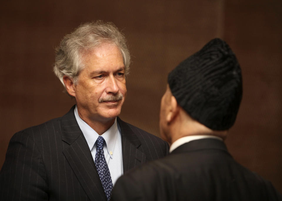 U.S. deputy Secretary of State William Burns, left, speaks with Libyan President Mohammed el-Megarif during a memorial service in Tripoli, Libya, Thursday, Sept. 20, 2012, for U.S. Ambassador to Libya, Chris Stevens, and three consulate staff killed in Benghazi on Sept. 11. The deputy U.S. secretary of state has met senior Libyan officials in Tripoli and attended a memorial service for the American ambassador and three consulate staffers killed in an attack last week. William Burns is the most senior US official to visit Libya in the aftermath of the Sept. 11 attack on the consulate in Benghazi and comes as Washington is still working to piece together how its top diplomat there, Ambassador Chris Stevens, was killed. (AP Photo/Abdel Magid al-Fergany)