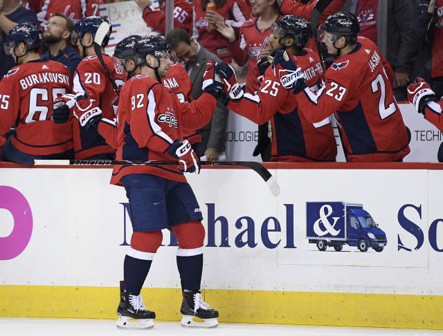 Washington Capitals center Evgeny Kuznetsov (92), of Russia, celebrates his goal with teammates on the bench during the first period of an NHL hockey game against the Vegas Golden Knights, Wednesday, Oct. 10, 2018, in Washington. (AP Photo/Nick Wass)